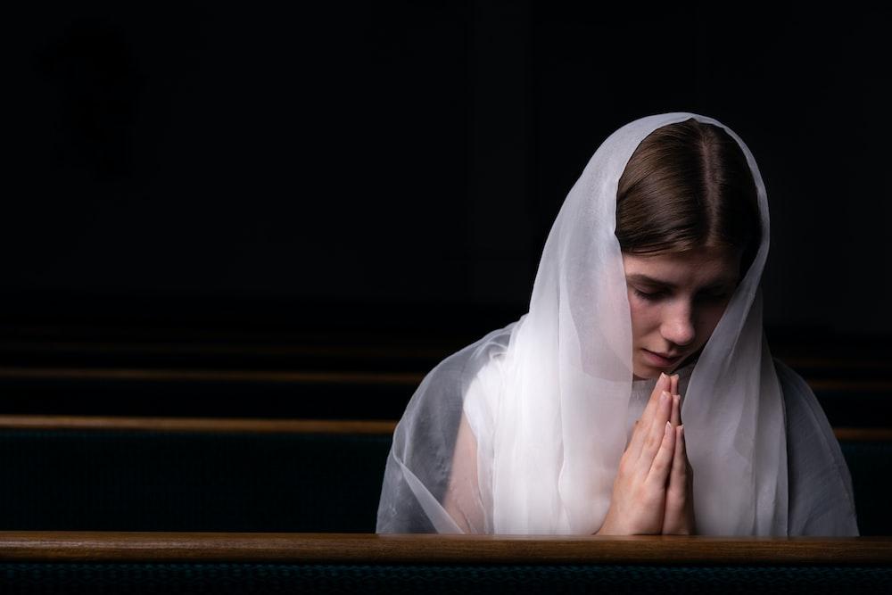 woman wearing white scarf