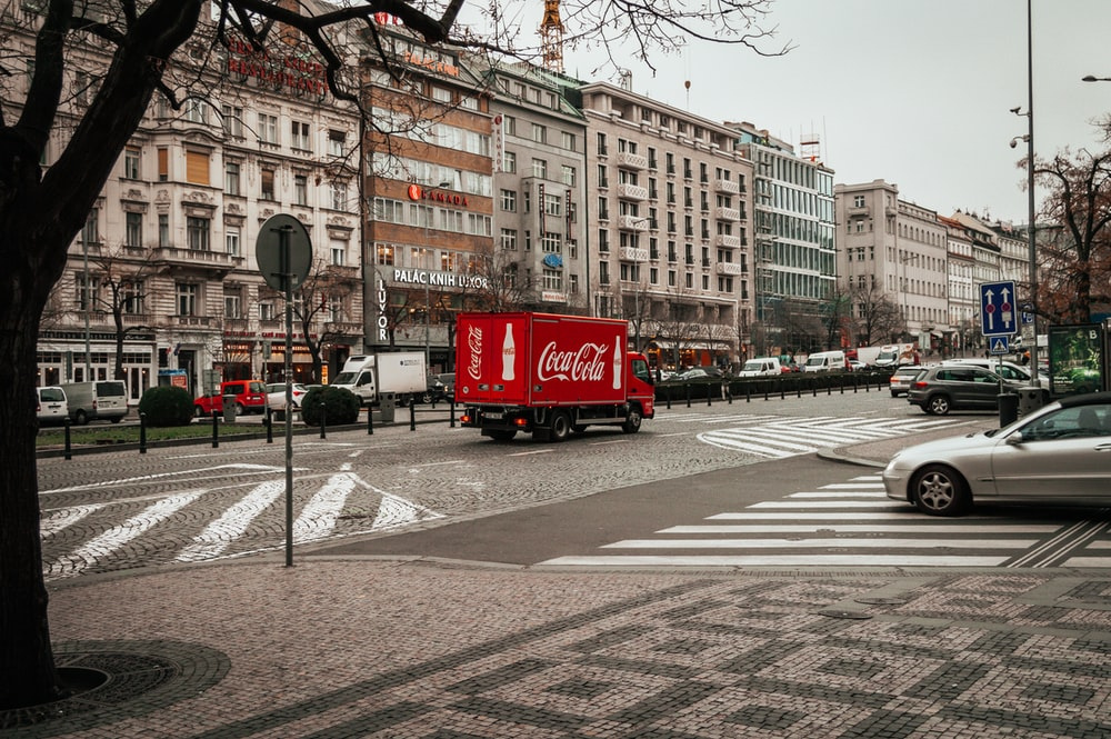 red Coca-Cola truck on road