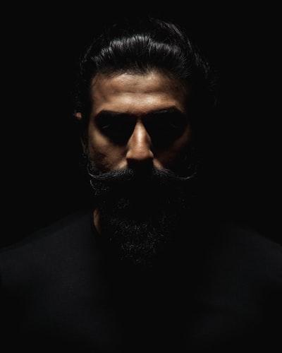 bearded man wearing black shirt