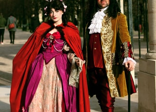 man and woman in character dresses