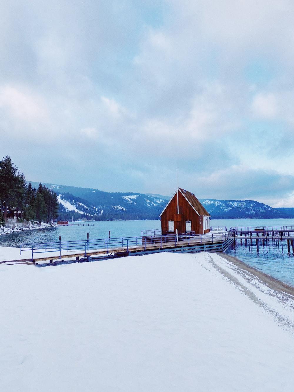 house on dock on lake