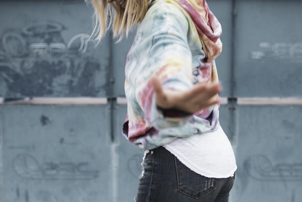 woman in long-sleeved top