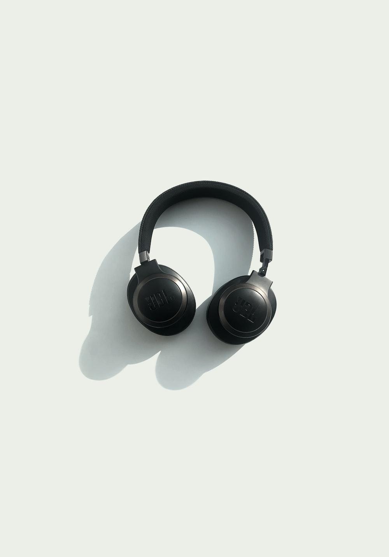 black JBL corded headphones on white panel