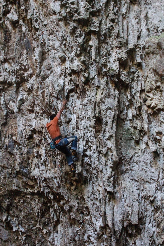 man climbing on rock formation