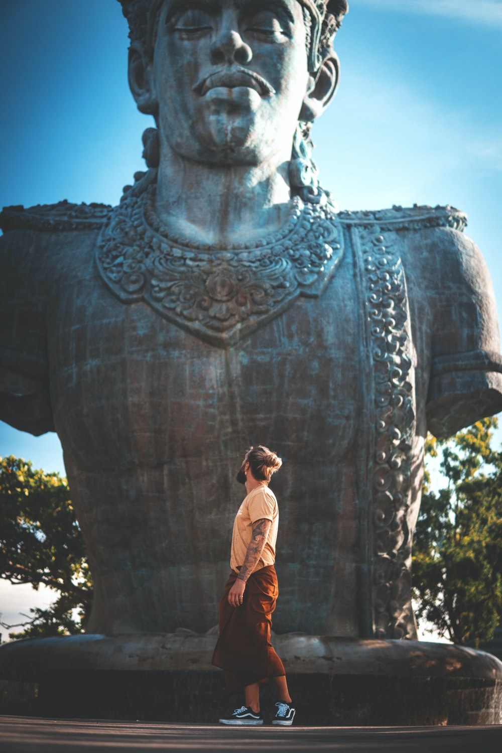 man standing in front of statue