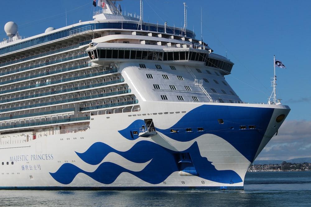white and blue cruiser ship