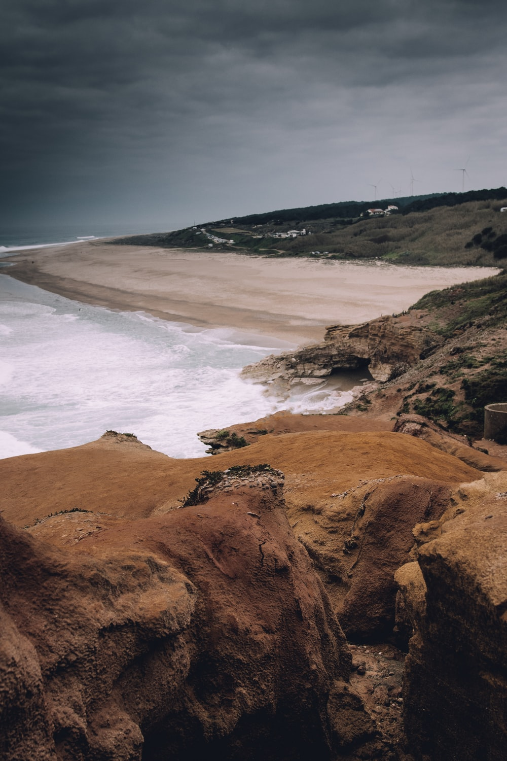 landscape photography of brown and green mountain range and shoreline