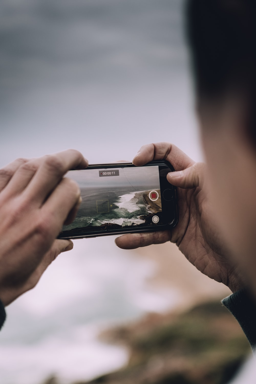 person holding space gray iPhone 6 displaying camera application