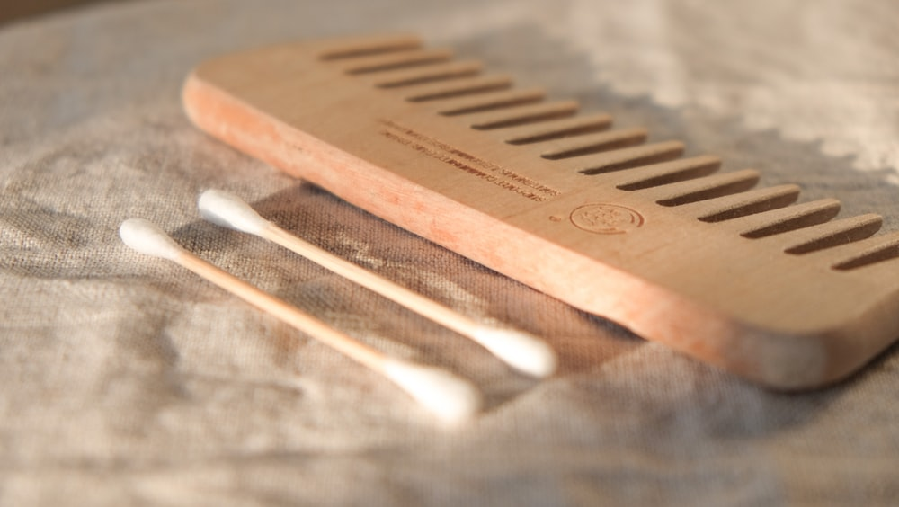 brown wooden hair comb