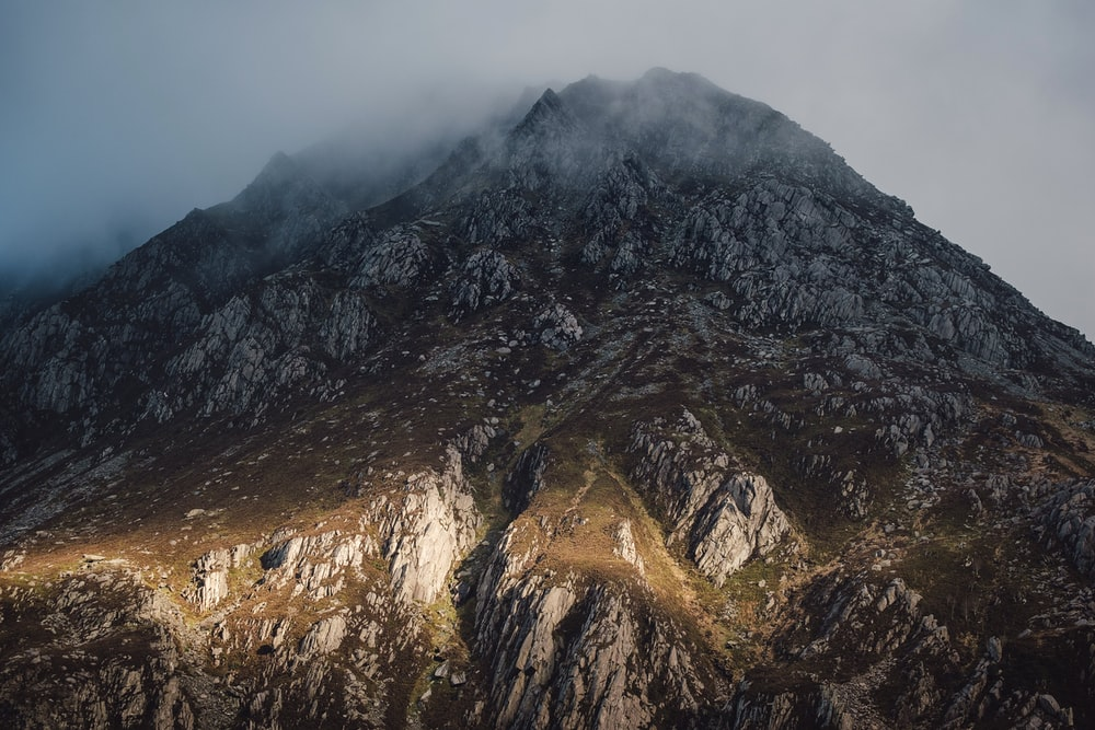 landscape photography of mountain covered with fogs