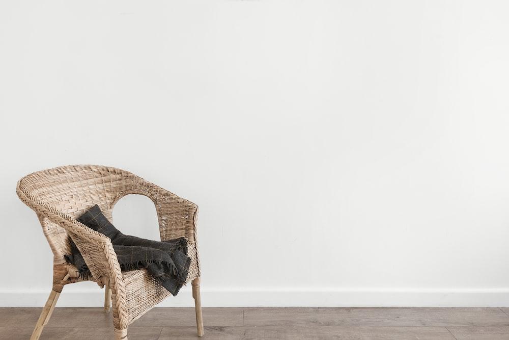 black textile on beige armchair