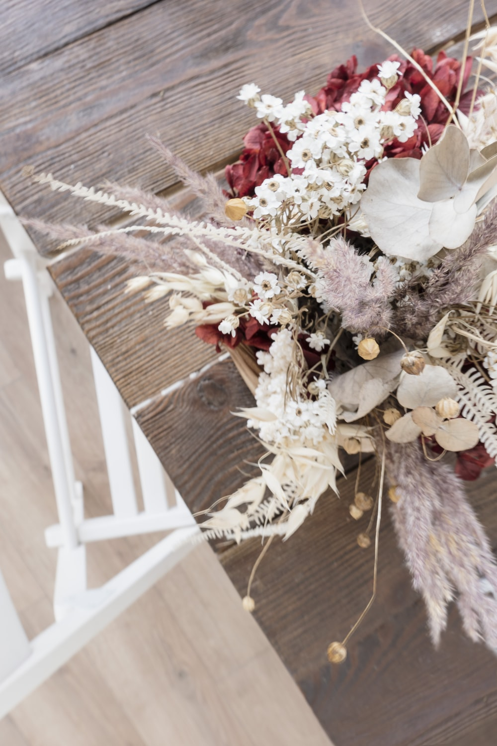 white and red table flower centerpiece