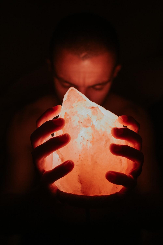 man holding Himalayan lamp