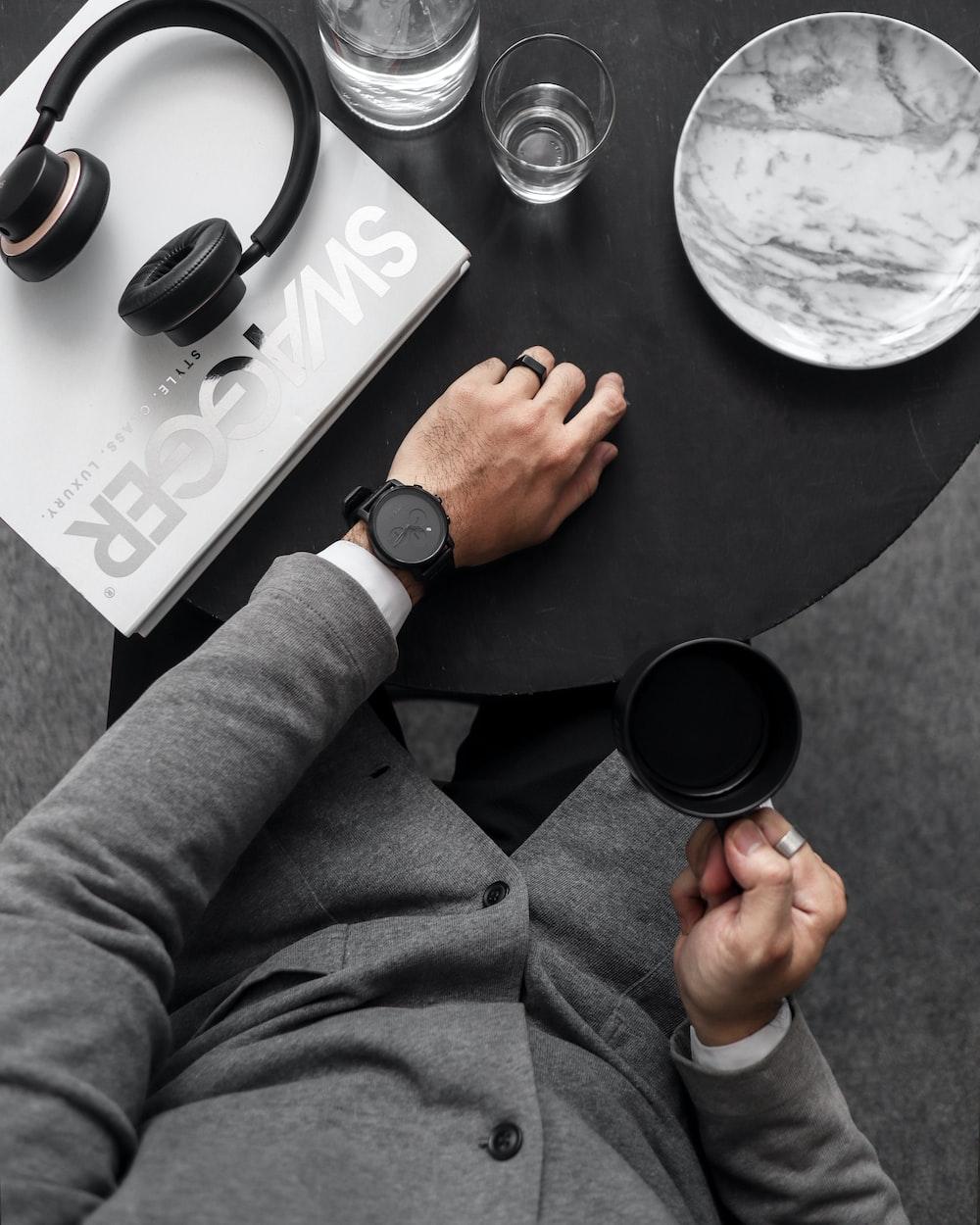 man holding coffee