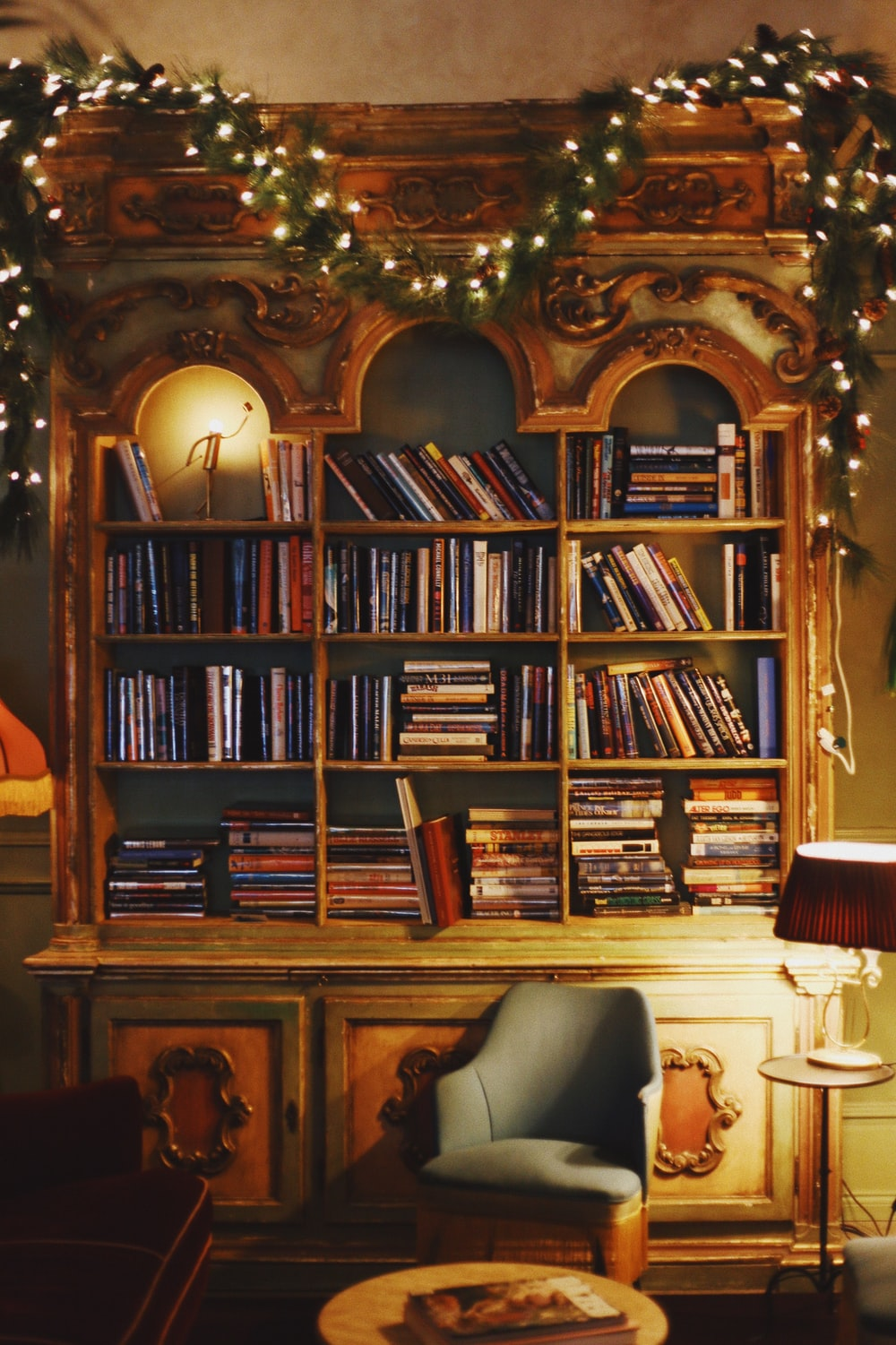 brown wooden bookcase of books