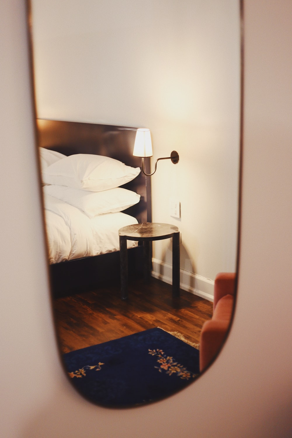 wall mirror view of bed
