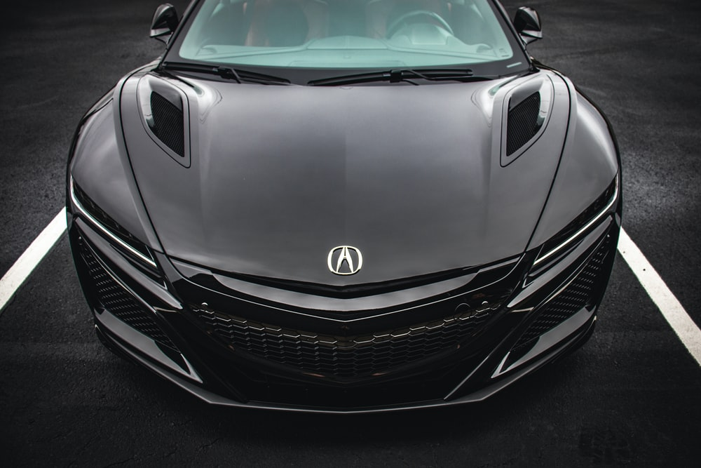 black Acura NSX coupe on paved road