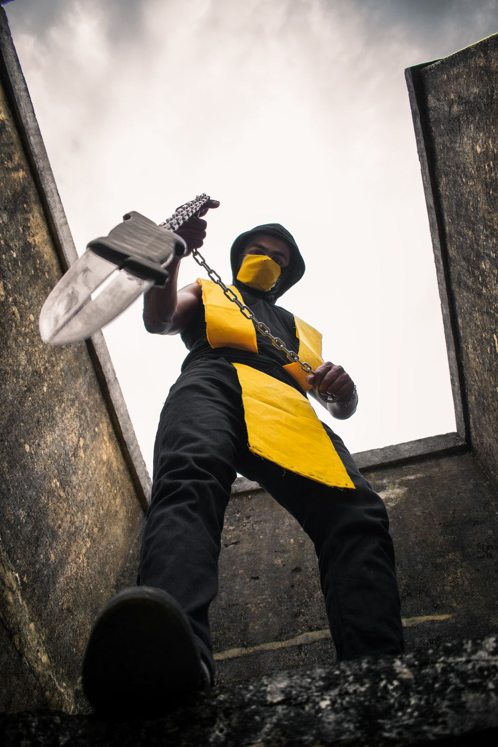 high-angle photography of Scorpion suited cosplayer