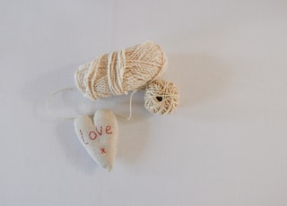 beige yarn and white love heart plush toy