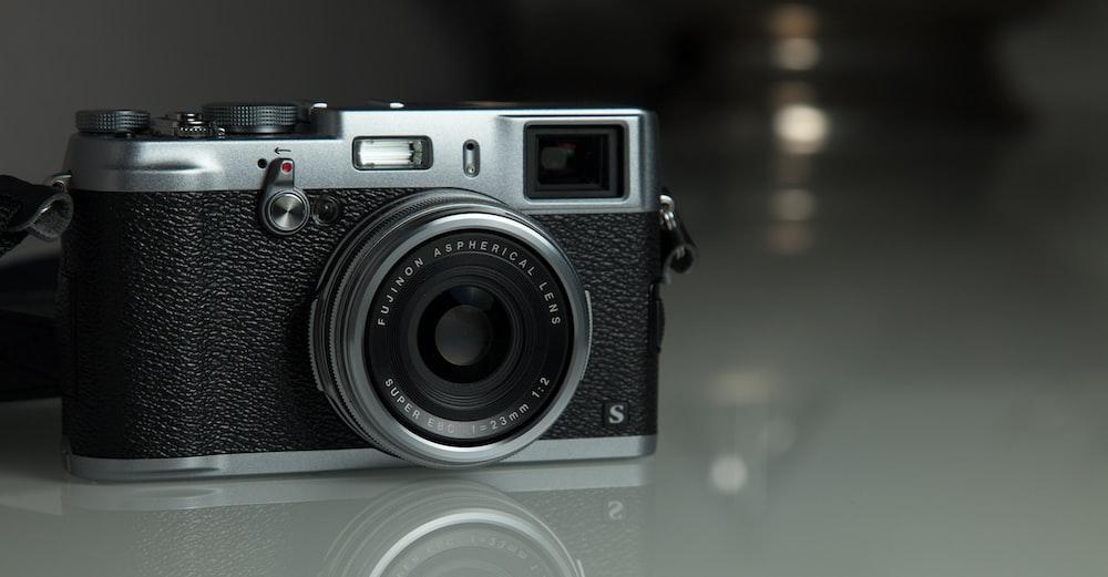 grayscale photo of camera