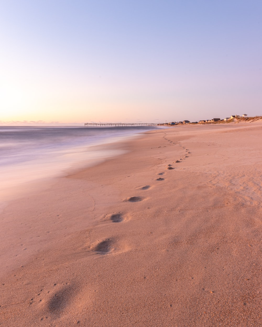 foot prints in the sands during daytime