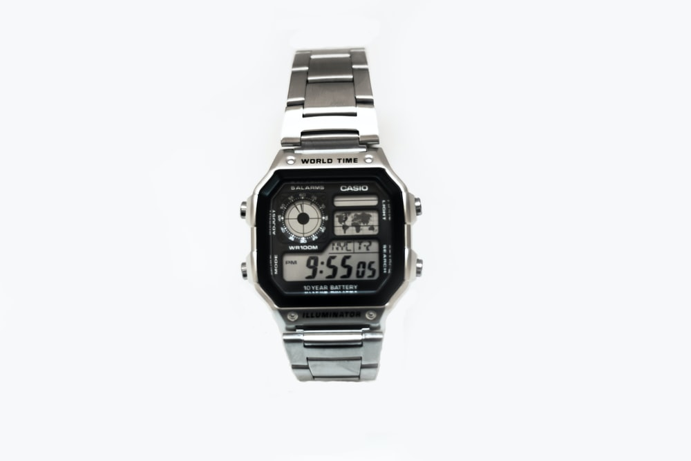 black and silver-colored Casio digital watch with link bracelet