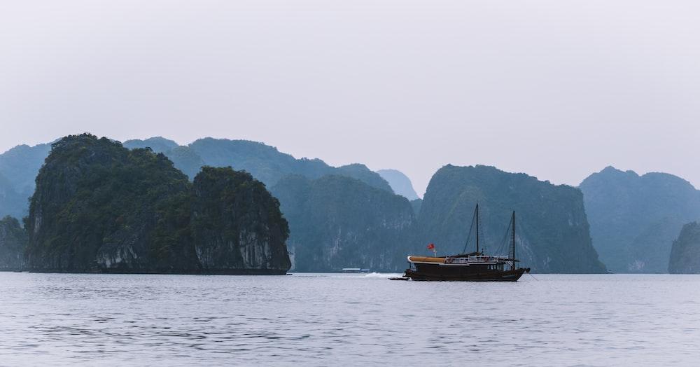 black boat near islet