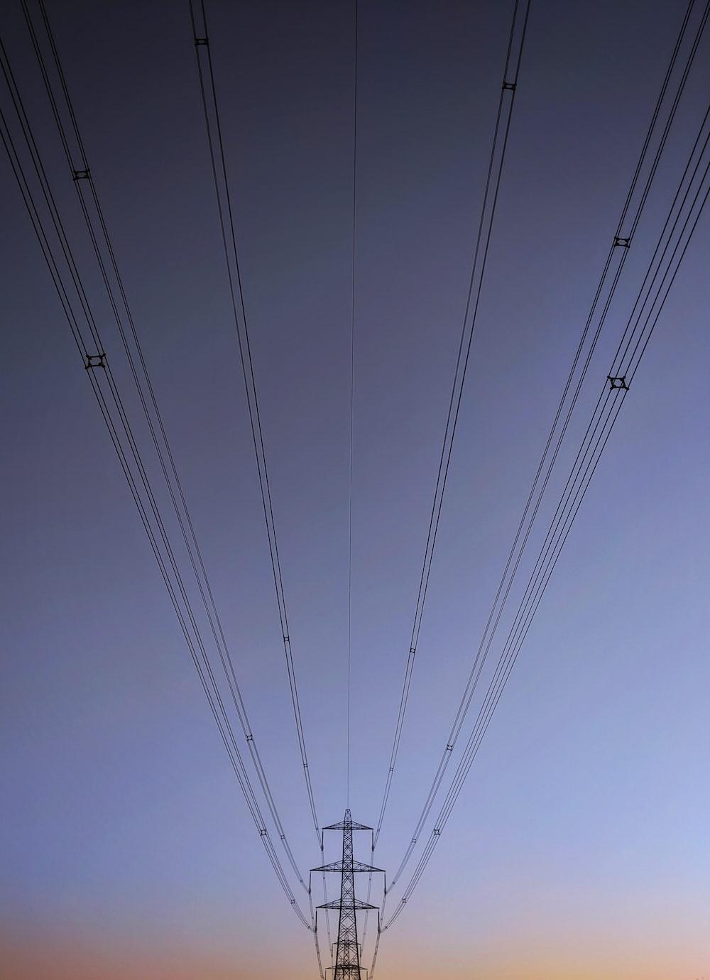 black electric wires under blue sky