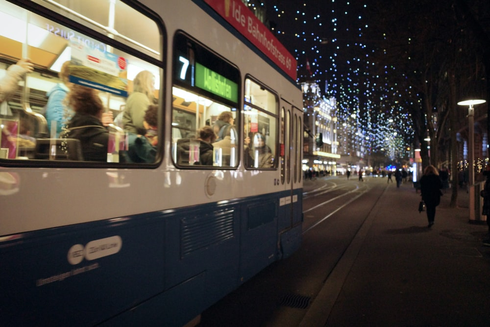 white and blue train at night