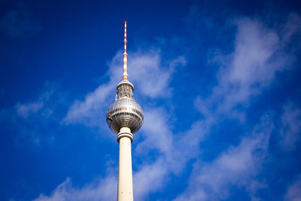 white tower under blue skies