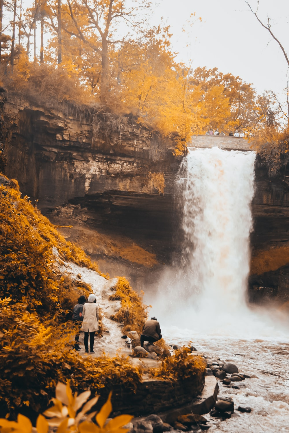 couple standing near the waterfalls photograph