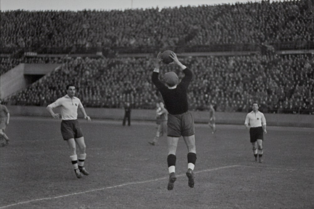 man throwing the ball on the field photograph