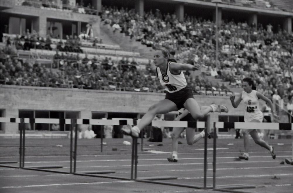 woman jumping on the hurdle photograph