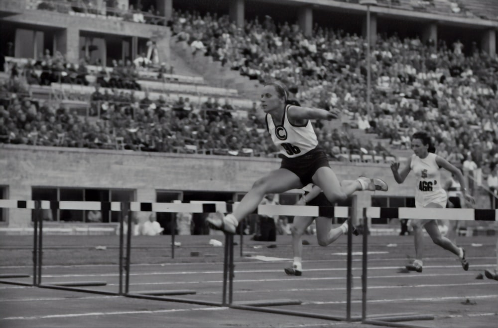 woman jumping on the hurdle photograph