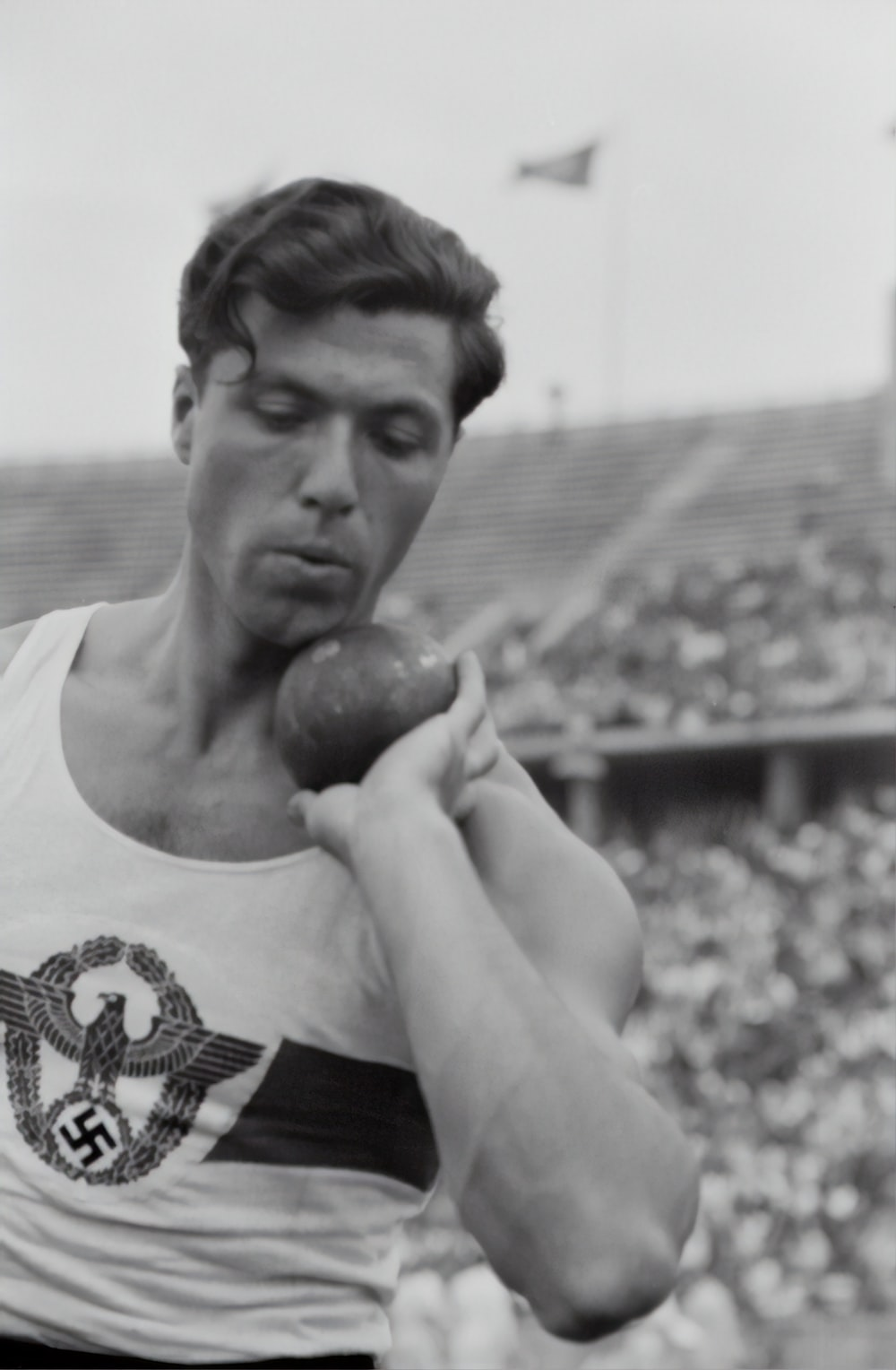 man holding discus ball