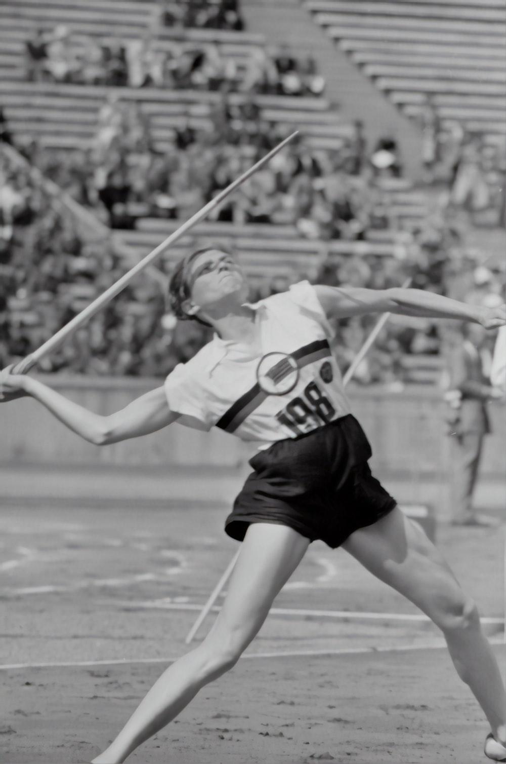woman doing javelin throw photograph