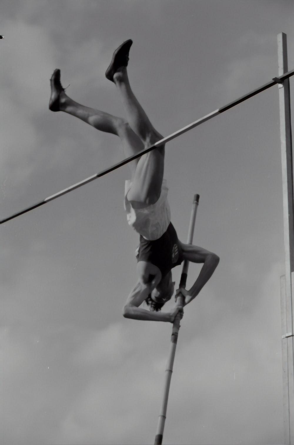 man holding pole stick