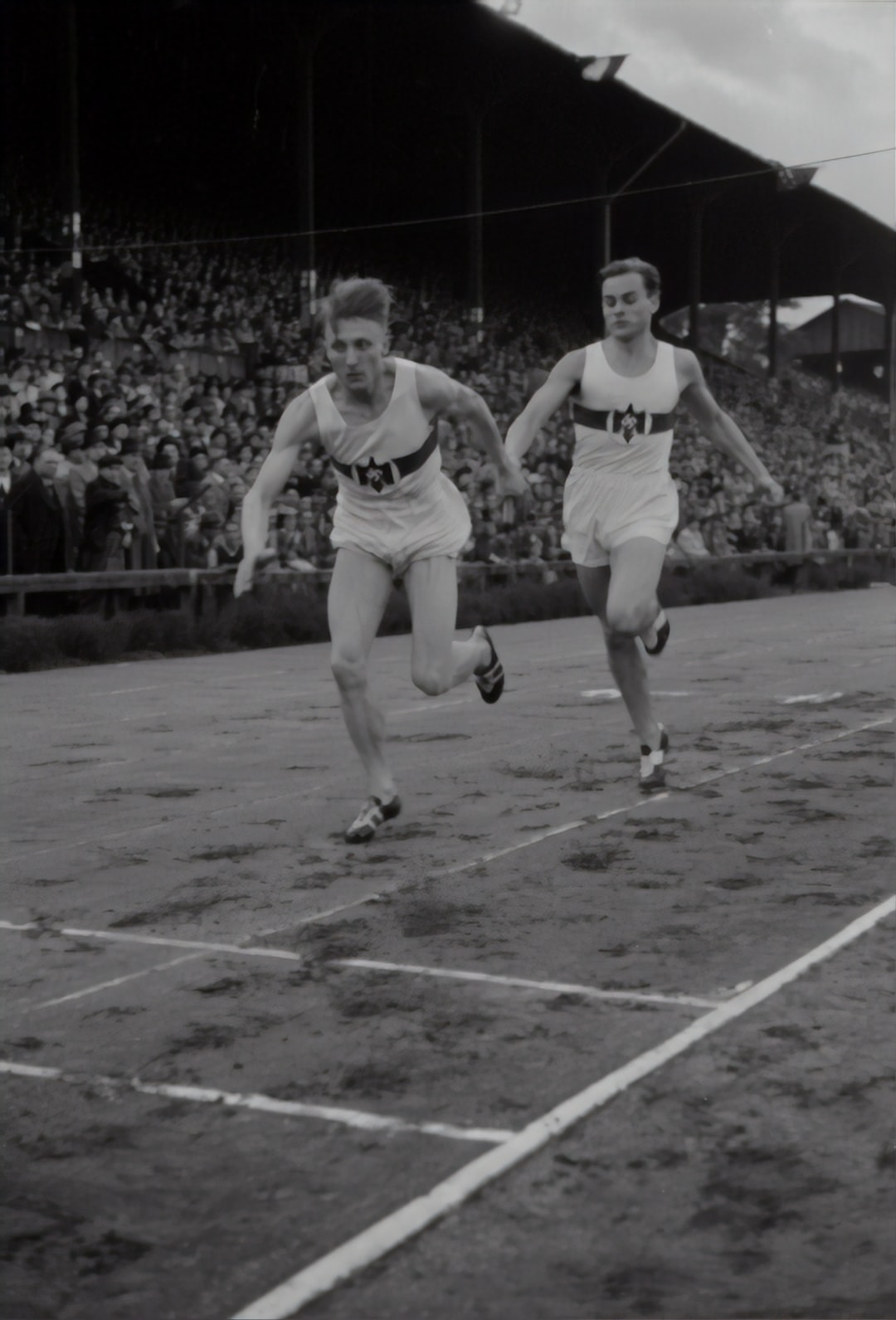 Relay race: German runner hands over the relay. Athletics championships 1940