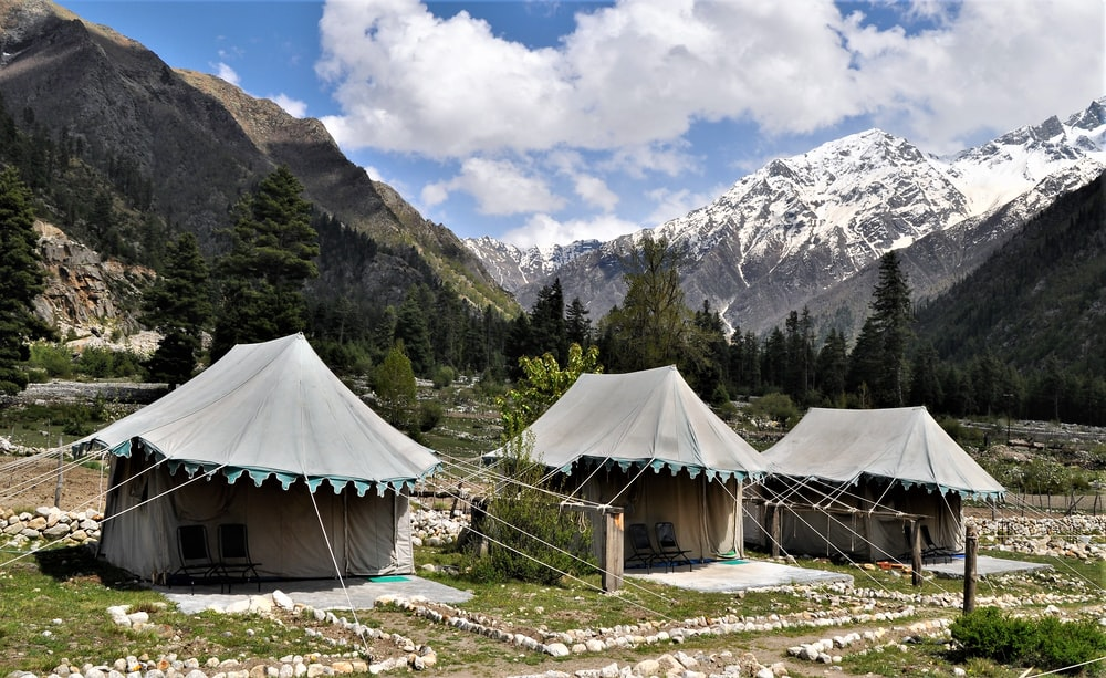 three gray-and-brown tents