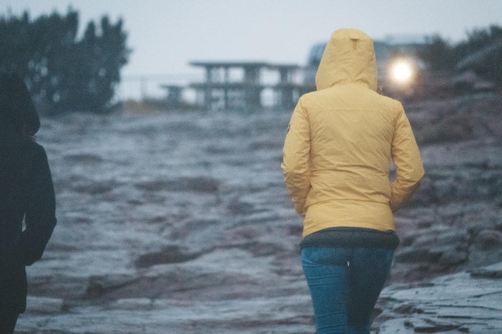 woman wearing yellow hoodie