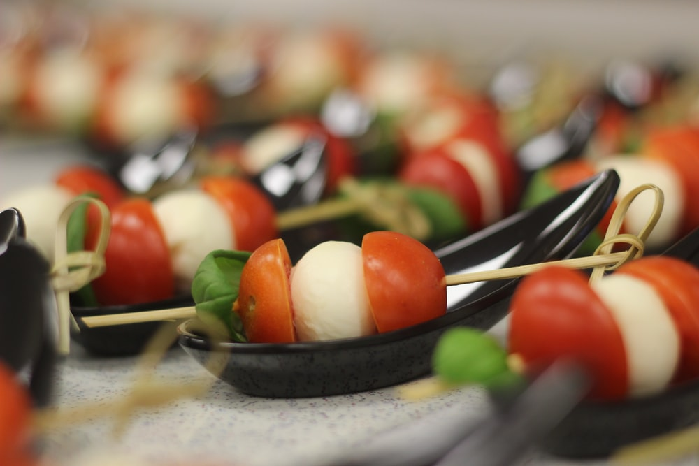 skewered tomato and cheese on plate