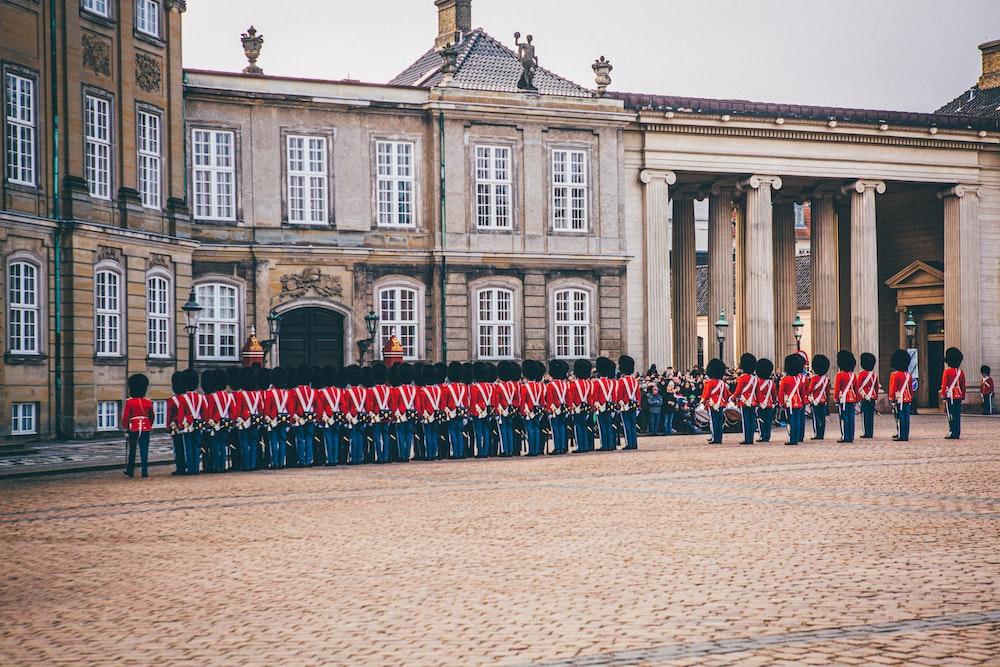 royal guard standing beside palace