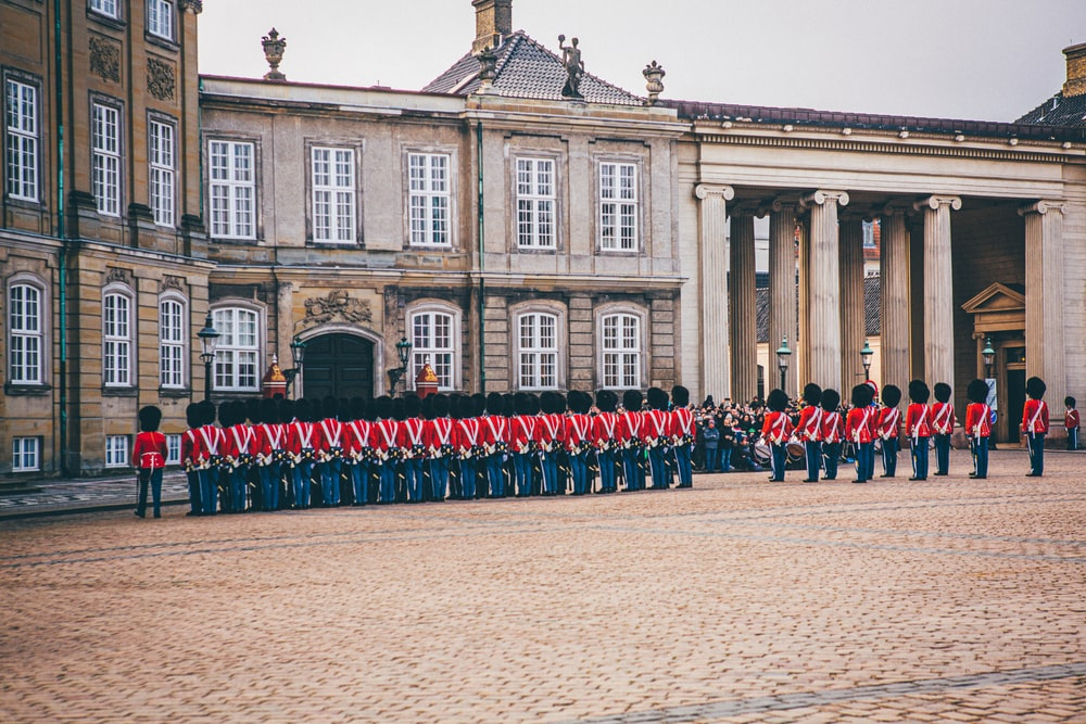 royal guard standing beside palace