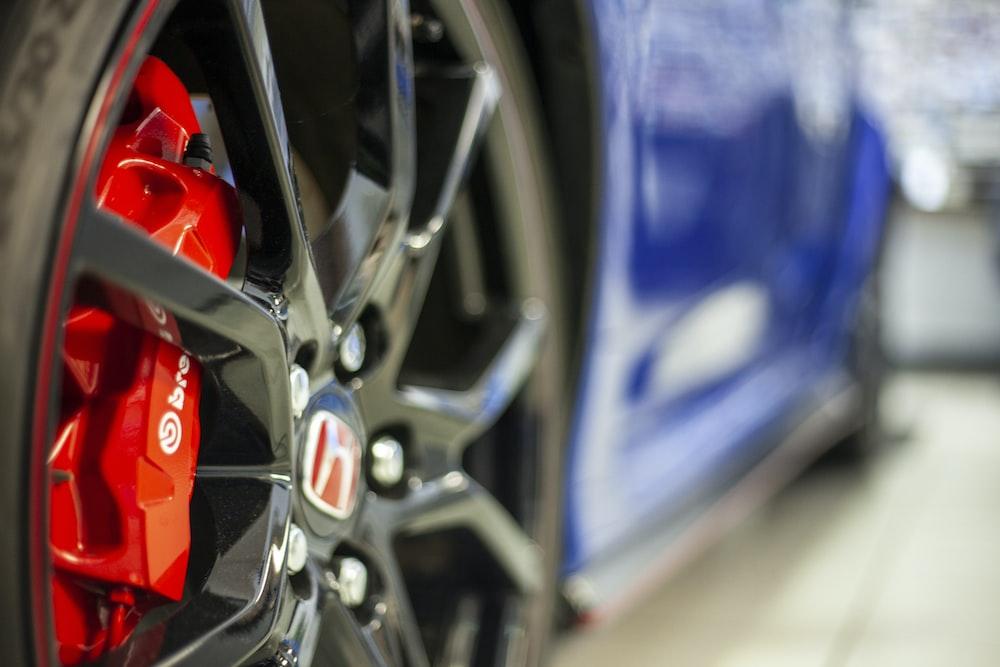 macro photography of black multi-spoke wheel and tire set