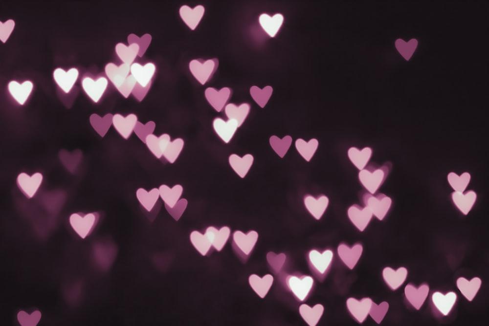Pink Hearts Lights On Black Background Photo Free Nature Image On Unsplash