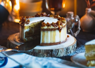 shallow focus photo of cake near lighted candle