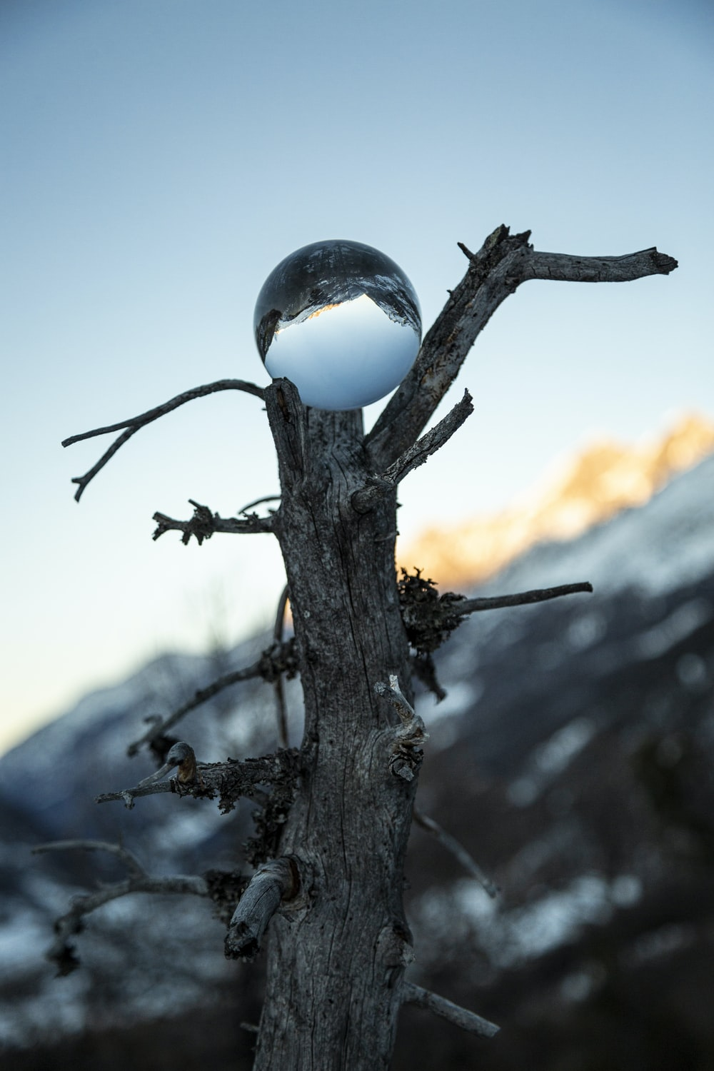 lensball photography of mountain and cliff