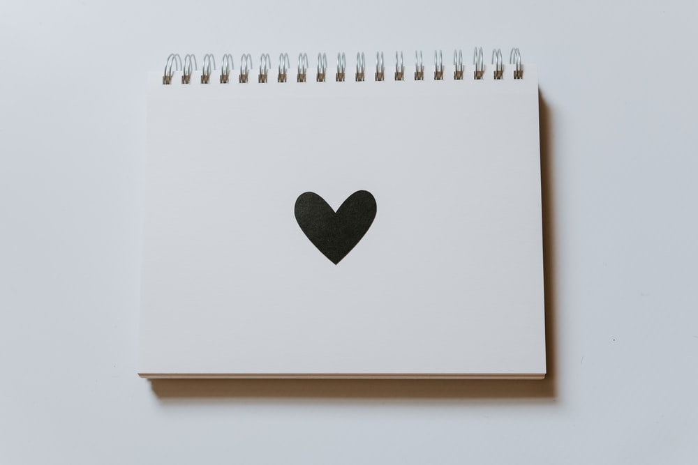black heart drawn on notebook