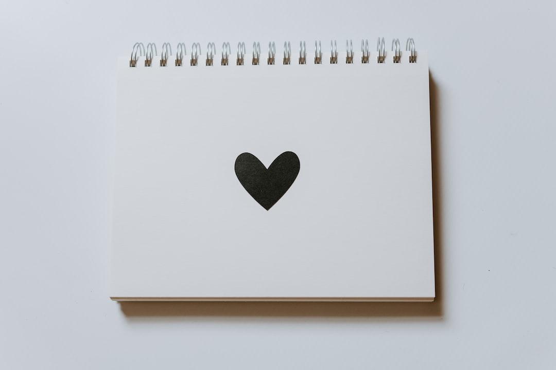 Black Heart On A Blank Notebook - unsplash