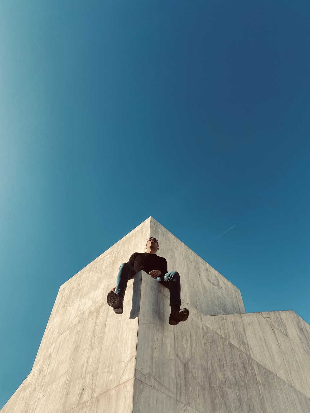 man sitting on the building